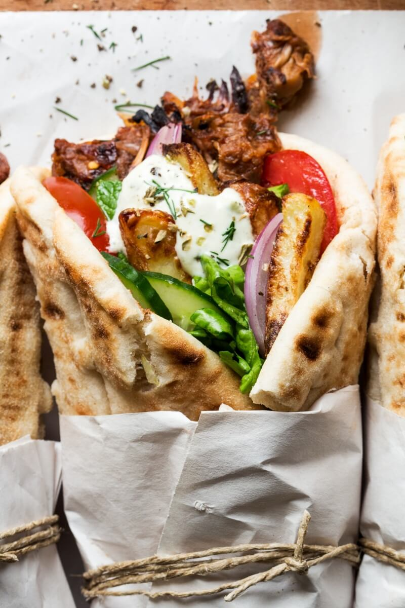 "Vegan Gyros // My personal favorite, the gyros. This ""European-style wrap"" is starting to get more and more popular in the USA. No wonder why. You can pack it full of veggies and fried tofu to make a crazy delicious meal. 