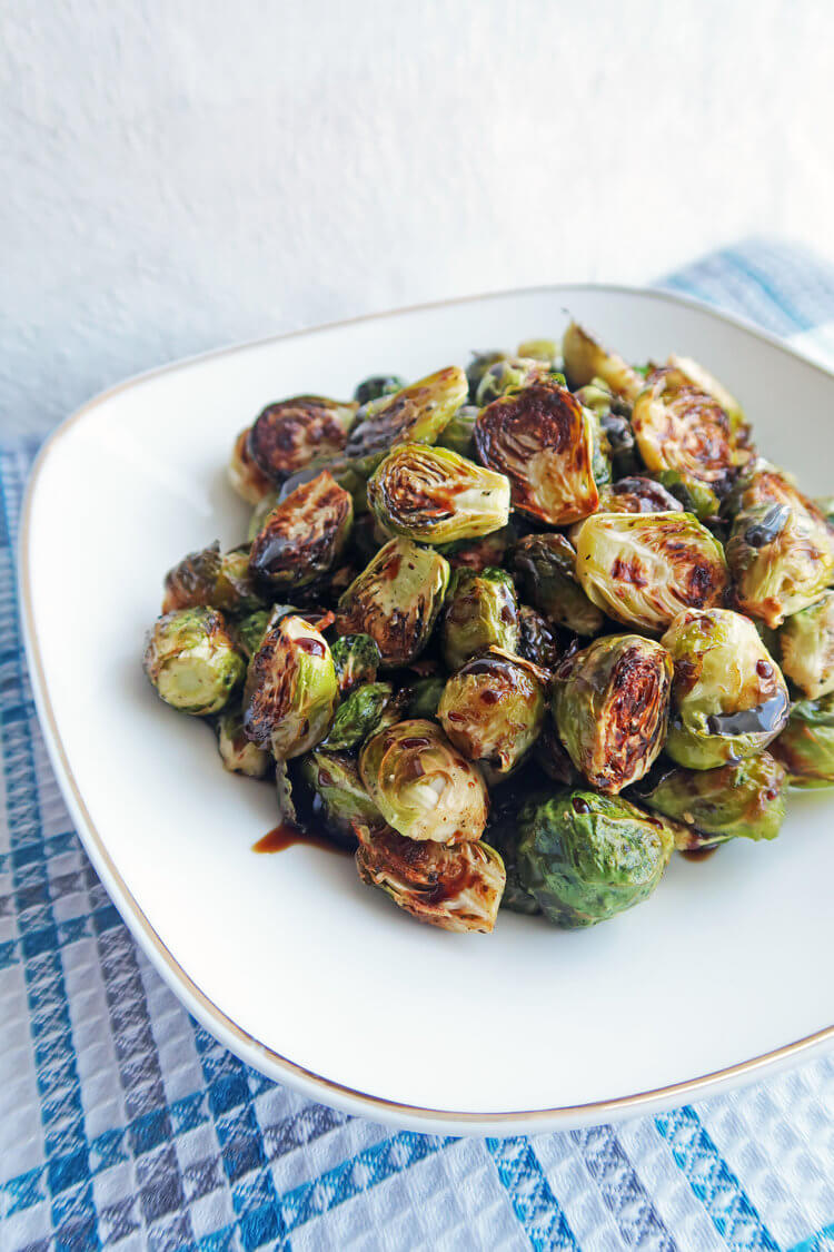 Vegan Balsamic Roasted Brussels Sprouts // You can make everyone love brussels sprouts, the key is an amazing balsamic roast. | The Green Loot ... #vegan #Christmas