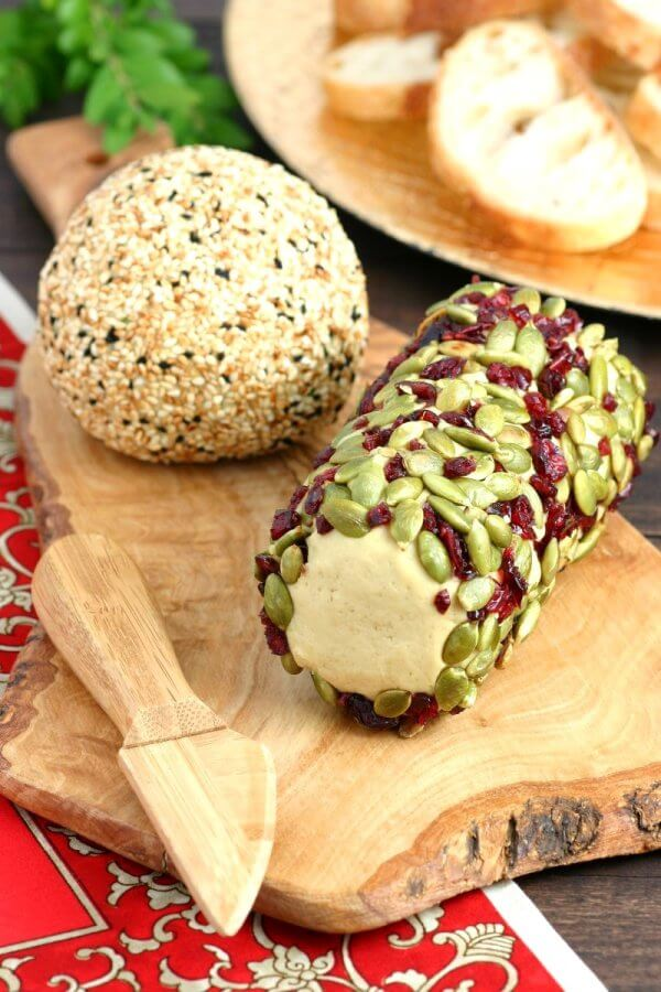 Vegan Nut Cheese Ball // Cheese balls are great for parties and get togethers but cheese rolls are even better. Decorate them with nuts and dried fruit for a beautiful and mouth-watering appetizer. | The Green Loot #vegan #dairyfree