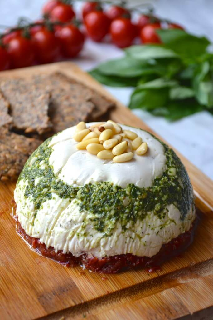 Vegan Goat Cheese Tower // You don't have to shed tears for you can never eat goat cheese again. This finger licking recipe has been created and it is exquisite. Made with dried tomatoes and pesto it is a rich and hearty cheese. | The Green Loot #vegan #dairyfree