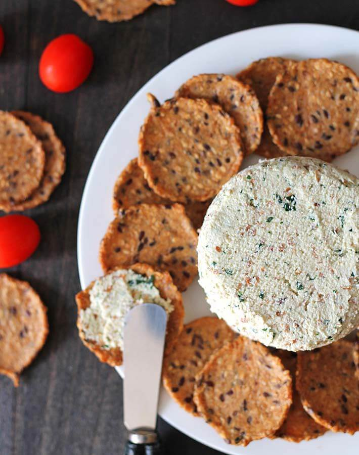 Vegan Almond Cheese Spread with Garlic Herb // Herbs and garlic were made for cheese like this one. Cracker up and enjoy the wonderfully distinct flavors. | The Green Loot #vegan #dairyfree