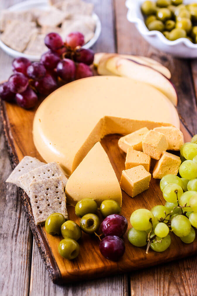 Vegan Cheddar Cheese // Recipe for the vegan version of Cheddar cheese. Originated from England, it's a hard cheese with a creamy flavor. | The Green Loot #vegan #dairyfree