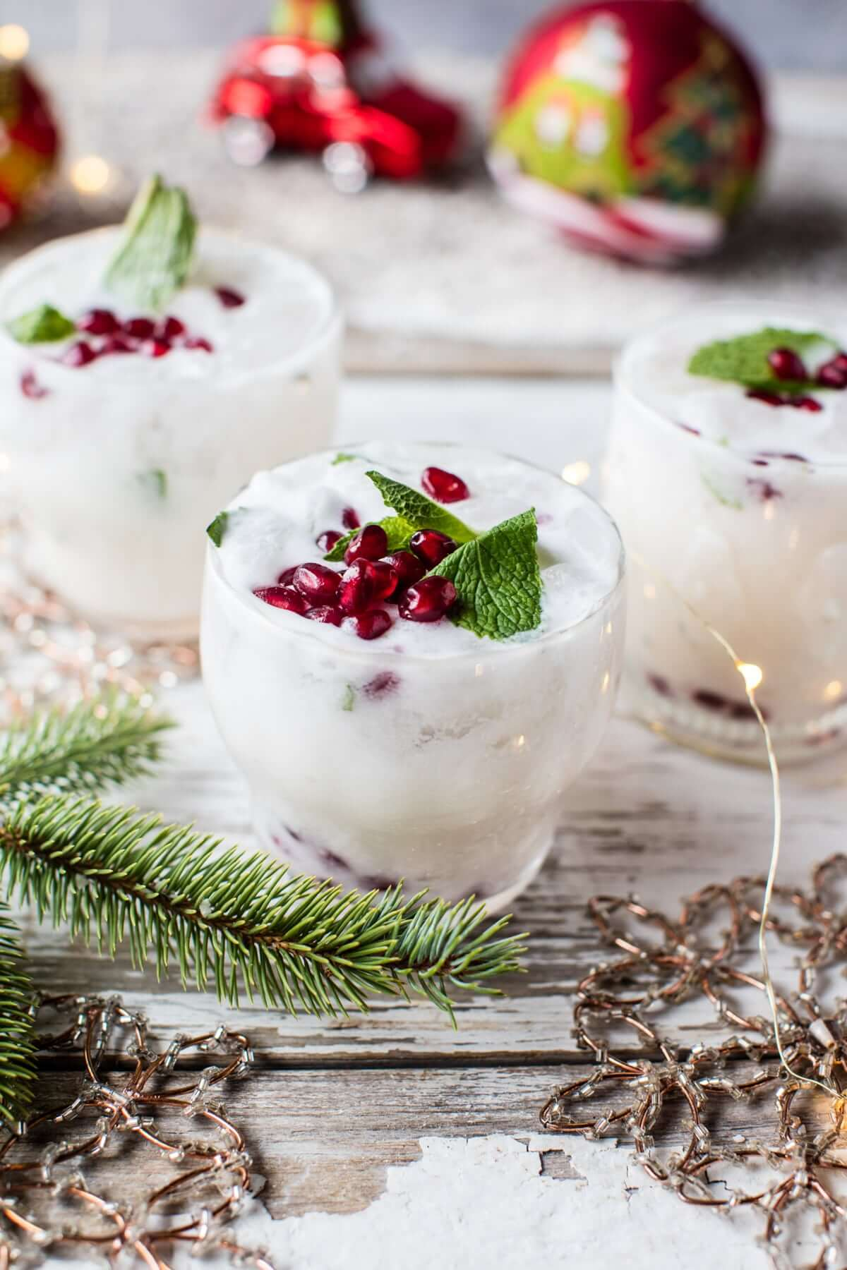 Vegan White Christmas Mojito // What better way to celebrate on Christmas day than with this snow-like Mojito? It's sweet and creamy and you will feel like dancing on clouds. | The Green Loot #vegan #Christmas
