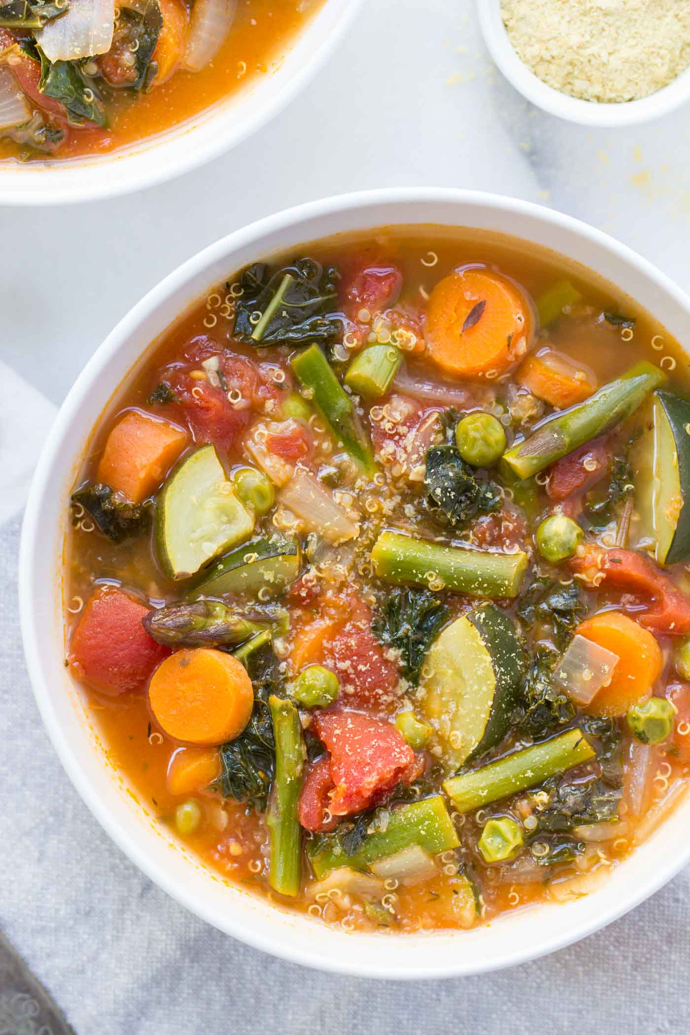 Vegan Spring Quinoa Minestrone // Minestrone is already a heavenly delicious soup, but if you put quinoa in it too, there's no reason left not to eat it every single day 'til June. | The Green Loot #vegan #cleaneating #weightloss