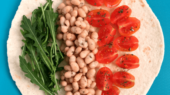 This tasty Bean Wrap is ready in 10 minutes, making it a perfect, quick weeknight dinner. It's packed with beans (protein), tomatoes and rockets/arugula (vitamins). | The Green Loot #vegan #dinner