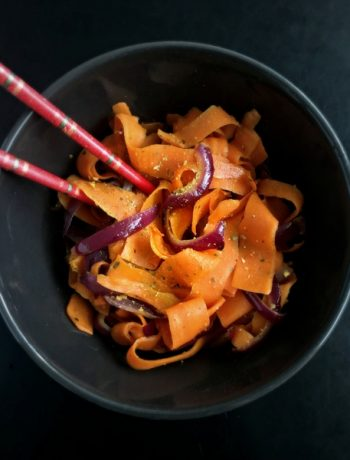 This vegan carrot ribbon stir fry is an easy, peppery side dish, that's ready in 20 minutes. Perfect as a healthy addition to your dinner on busy weeknights.   The Green Loot #vegan