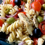 """This vegan """"cheesy"""" Italian pasta salad makes a great light lunch/dinner that you can enjoy warm or cold. Perfect to take with you to school and work. 