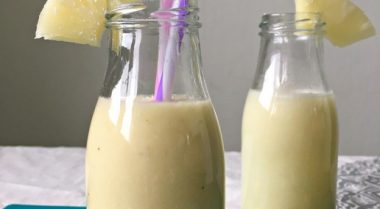 "This vegan Piña Colada Smoothie is made with pineapples and coconut. Perfect for a healthy breakfast drink or a non-alcoholic ""cocktail""! A tasty way to sneak some holiday feel in your weekdays. 