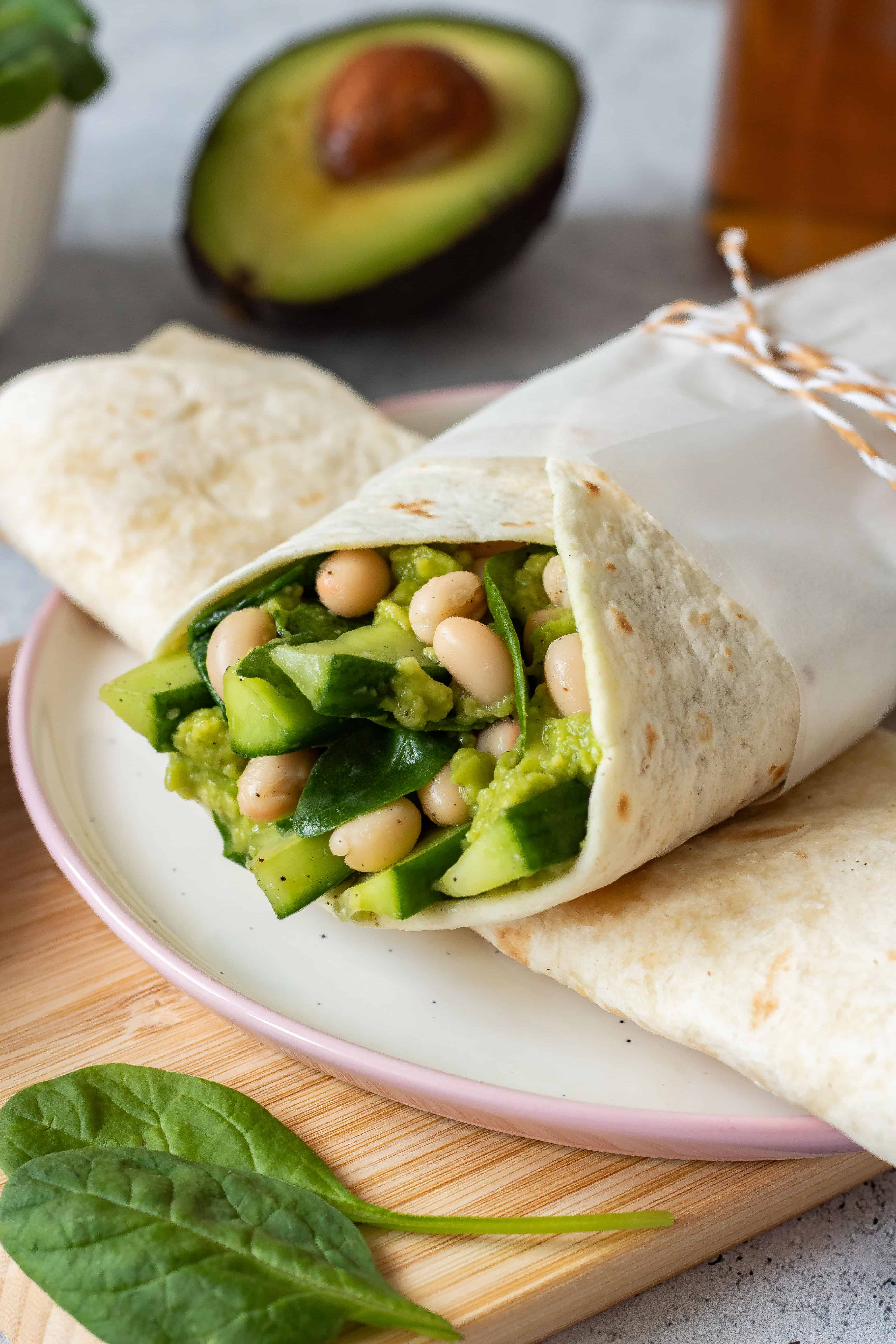 Avocado White Bean Wrap - made with spinach and cucumber. A super green, filling, protein-rich wrap that makes a perfect lunch to take with you. You can make it part of your weight loss diet as well. | The Green Loot #vegan #veganrecipes #dairyfree #healthyeating