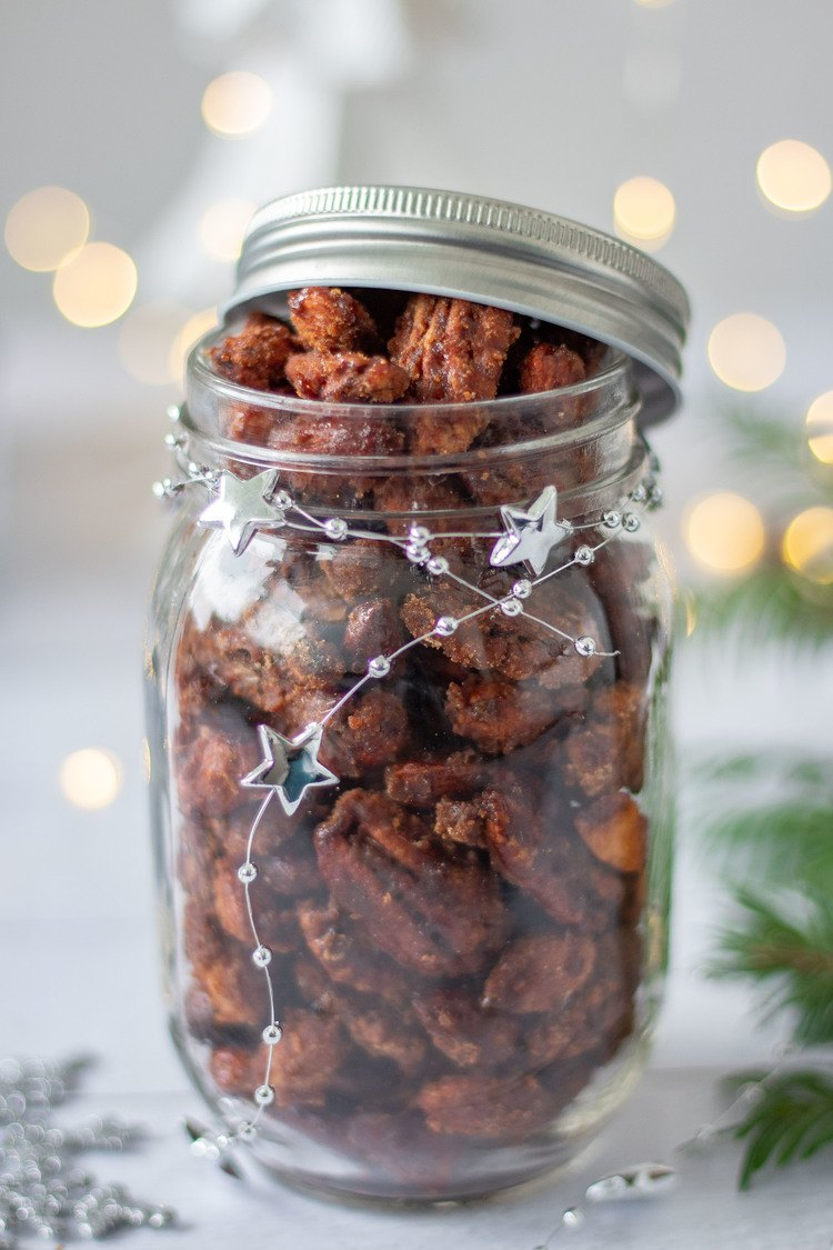 Gingerbread Candied Nuts in a jar with half the lid on