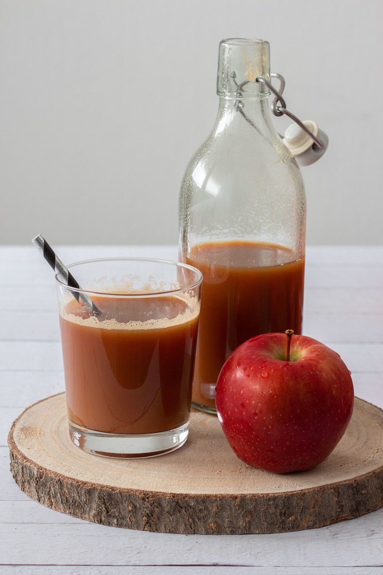 Homemade Apple Juice in a glass and bottle